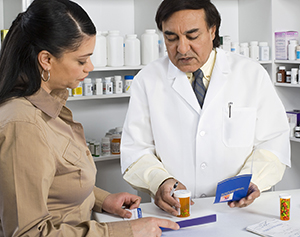 Woman talking with a pharmacist about medications
