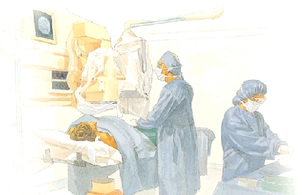 Person lying on table underneath x-ray machine. Person is covered with hospital blankets. Healthcare provider with surgical gown, gloves, hat, and mask are standing at side of table performing procedure, looking at video monitor. Another healthcare provider is working at side table.