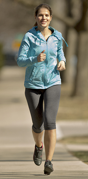 Woman jogging outdoors.